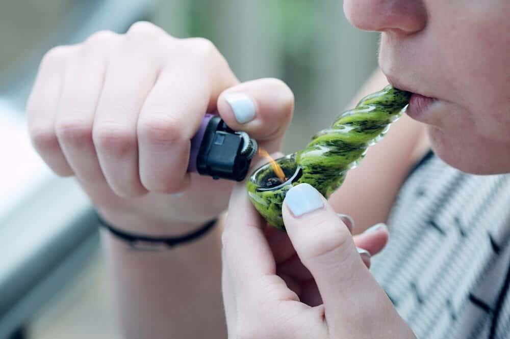 Person smoking CBD to relief anxiety